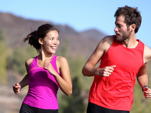Happy couple running